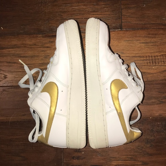 Nike Air Force Ones sneakers white and gold